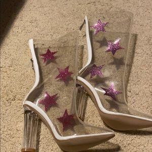 Clear, high heel boots with purple glitter stars.